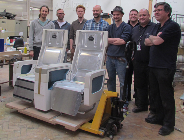 A proud team around the last full size mock-up seat